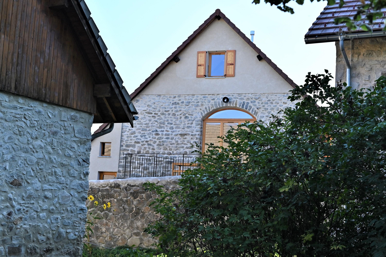 façade ouest avec terrasse au soleil couchant